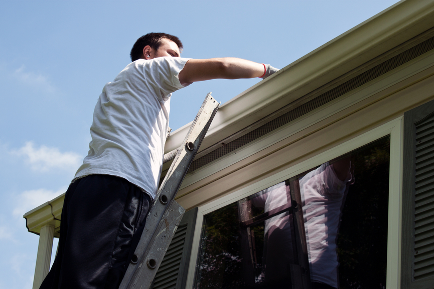 Gutters and Downspouts being cleaned.